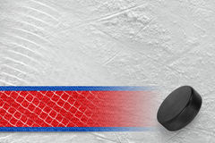 Hockey Puck, a red line and a fragment of the grid Royalty Free Stock Image