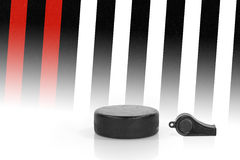 Hockey puck and referee whistle Stock Photography