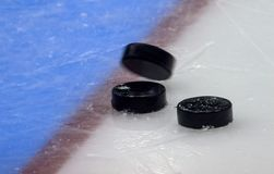 Hockey puck stand on side on goal line. Close view stock photography