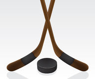 Hockey puck and stick Stock Photography