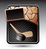 Hockey puck and stick on bronze cracked ad Stock Photography