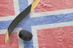 Hockey puck and stick Royalty Free Stock Photography