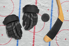 Hockey puck, stick and gloves Stock Photography