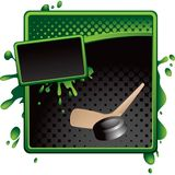 Hockey puck and stick on green and black halftone Stock Photo
