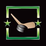 Hockey puck and stick on green star frame Stock Image