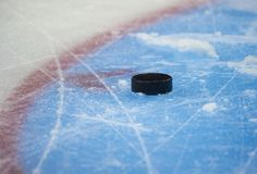 Hockey puck and stick on the ice arena. Texture, background, concept royalty free stock photos