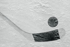 Hockey puck and stick on the ice Royalty Free Stock Photography
