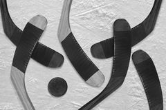 Hockey puck and stick on the ice Royalty Free Stock Photos