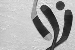 Hockey puck and stick on the ice three Royalty Free Stock Image
