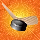 Hockey puck and stick orange starburst Royalty Free Stock Photo