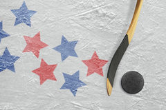 Hockey puck, stick and star Royalty Free Stock Photography