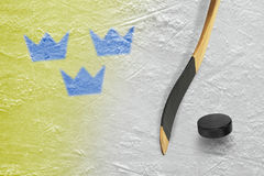 Hockey puck, stick and three crowns Stock Photo