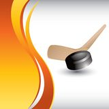 Hockey puck and stick on vertical orange wave ad Royalty Free Stock Photos
