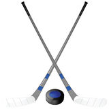 Hockey puck and sticks Stock Image