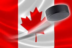Hockey Puck Streaks Across Canadian Flag Imagenes de archivo