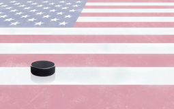 Hockey Puck and USA Flag on Ice With Copy Space Stock Image