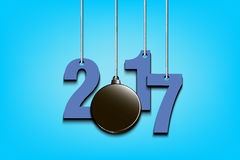 Hockey puckl and 2017 hanging on strings. New Year numbers 2017 and hockey puck as a Christmas decorations hanging on strings. Vector illustration Royalty Free Stock Images