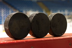 Hockey Pucks on Bench Royalty Free Stock Photo