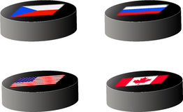 Hockey pucks with flags Royalty Free Stock Images