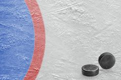 Hockey pucks and a fragment of the goalkeeper`s field. Fragment of the goalkeeper`s field and hockey pucks. Concept, hockey, background Stock Images