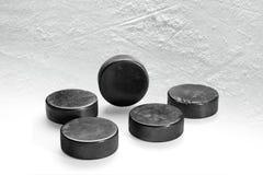 Hockey pucks on ice. Fragment of ice hockey platform with washers. Concept, hockey Stock Photo