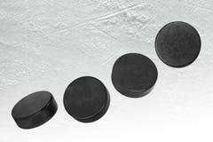 Hockey pucks on ice. Washers on the ice of the hockey field. Texture, background, concept, hockey Stock Photo