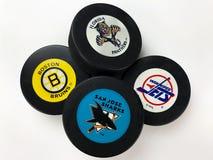 Hockey Pucks. National Hockey League vintage pucks with old team logos stock photography