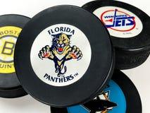 Hockey Pucks. National Hockey League vintage pucks with old team logos Stock Image