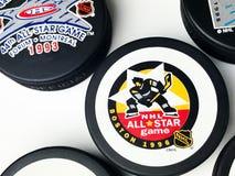 Hockey Pucks. National Hockey League vintage pucks with old team logos Royalty Free Stock Photos