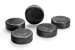 Hockey pucks on a white background. Texture, background, concept Royalty Free Stock Image