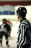 Hockey referee. A referee watching a youth ice hockey game royalty free stock photography