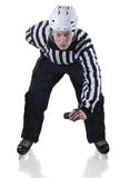 Hockey referee on face off position. Hockey referee holding a puck in face off position. Front view. White background with shadow Stock Photo
