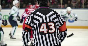 Hockey referee hold a puck in his palm stock video footage
