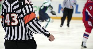 Hockey referee hold a puck in his palm. Slow stock footage