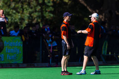 Hockey Referees Decisions on Play. Hockey referees have a quick talk on a decision to make of a play between players. First teams high school derby game between Royalty Free Stock Image