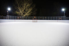 Hockey rink net. Photo of a hockey net on an outdoor rink at night Royalty Free Stock Photos