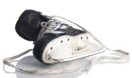 Hockey skate. Black mens hockey skate isolated on white background royalty free stock photo