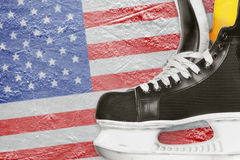 Hockey skates and American flag Stock Photos