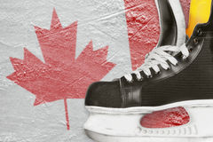 Hockey skates and Canadian flag Royalty Free Stock Image