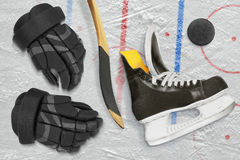 Hockey skates, gloves, stick and puck Royalty Free Stock Image