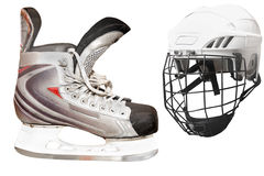 Hockey skates and helmet Stock Images