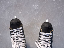Hockey skates on ice Stock Photos