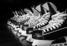 Hockey skates lined up in locker room Royalty Free Stock Photography