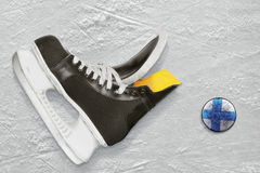Hockey skates and puck Stock Photography