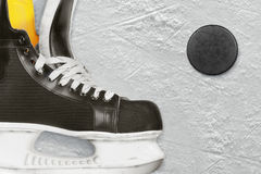 Hockey skates and puck Royalty Free Stock Images
