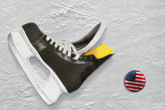 Hockey skates and puck Royalty Free Stock Photography