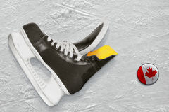 Hockey skates and puck Royalty Free Stock Image