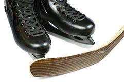 Hockey skates and stick Royalty Free Stock Photos