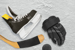 Hockey skates, stick, gloves and puck Royalty Free Stock Images