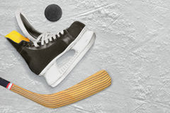 Hockey skates, stick and puck Stock Image